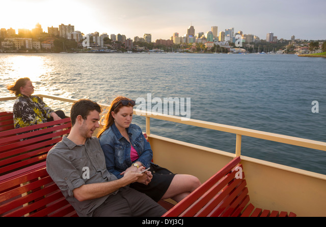 Australia NSW New South Wales Sydney Sydney Harbour harbor Parramatta River Mosmon Bay F2 ferry man woman couple - Stock Image
