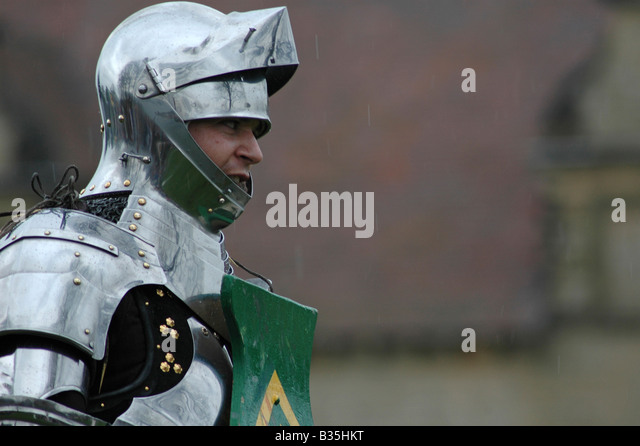 Knight in armour with helmet and shield - Stock Image