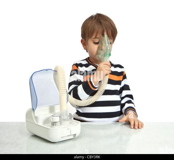 little boy makes inhalation with nebuliser - Stock Image