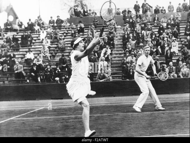 Americans Helen Wills Moody and Sidney Wood, in mixed doubles play in France. May 31, 1932. They placed second, - Stock Image