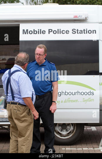 Police Community Support Officers give advice and help tpo shoppers at a garden centre/center - Stock Image