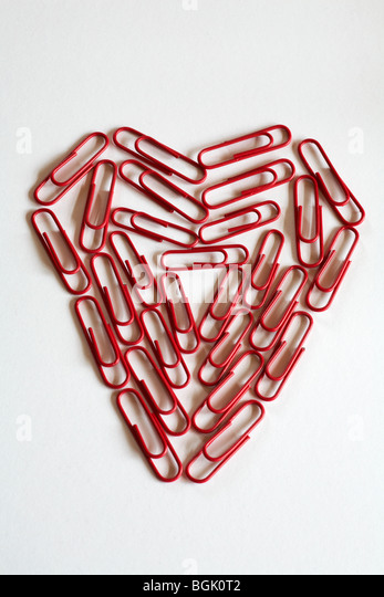 office romance - heart of paper clips - Stock Image