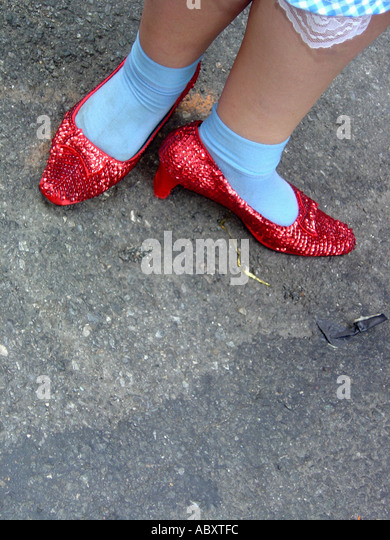 Ruby Slippers on Feet of Person Ruby Slippers on Feet of Person Dressed as Dorothy from Wizard of Oz at Gay Pride - Stock-Bilder