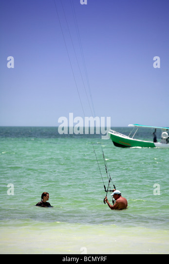 Man and Young woman kite surfing on Holbox island, Quintana Roo, Yucatán Peninsula, Mexico, a unique Mexican - Stock Image