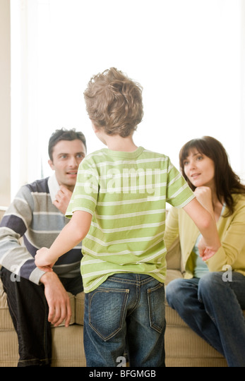 son telling story to parents - Stock Image