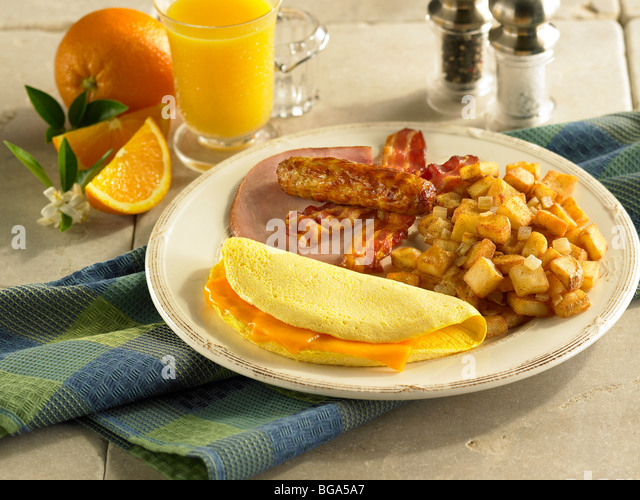 Cheese omelet with sausage, bacon, ham and country potatoes - Stock Image