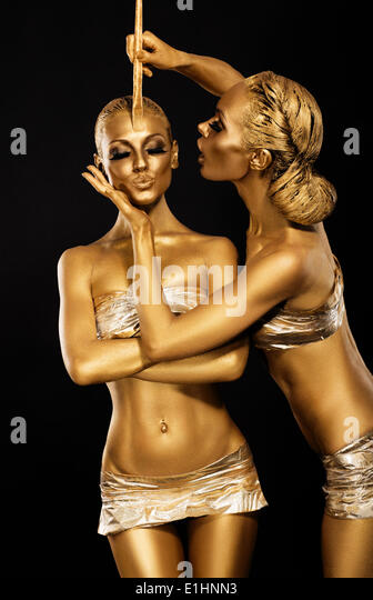 Fantasy. Creativity. Shiny Women's Gold Gilded Bodies. Arts - Stock Image