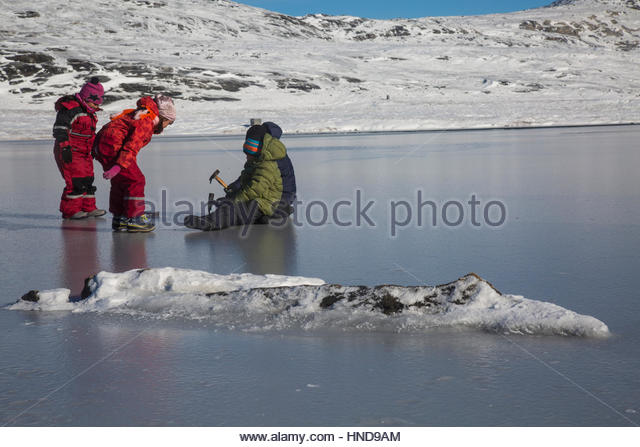 Greenlandic Children Playing on Ice - Stock Image