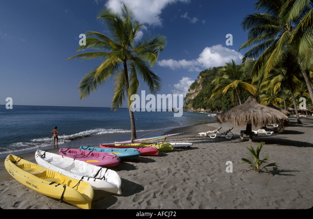 West Indies St. Lucia Anse Chastanet Resort rental kayaks palm tree Caribbean Sea shore - Stock Image