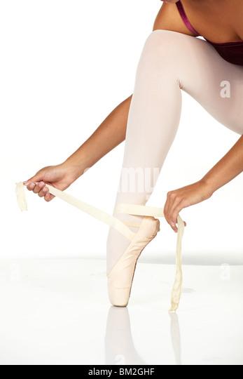 Ballet Dancer Tying Shoes