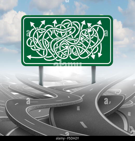 Business confused choice concept and bureaucracy symbol as a group of roads tangled with a green highway sign with - Stock Image