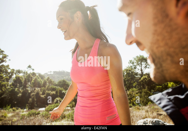 Happy couple in forest - Stock Image