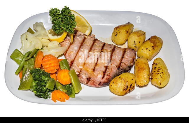 Tuna steak locally caught fish with vegetables and potatoes on white plate, Algarve - Stock Image