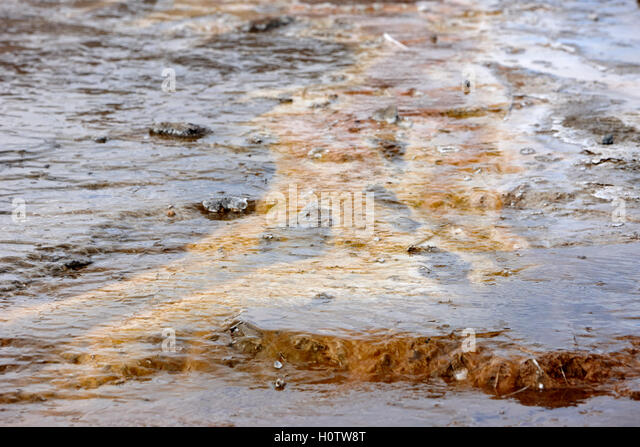 chemical and geological deposits caused by geyser water overflow geysir Iceland - Stock Image