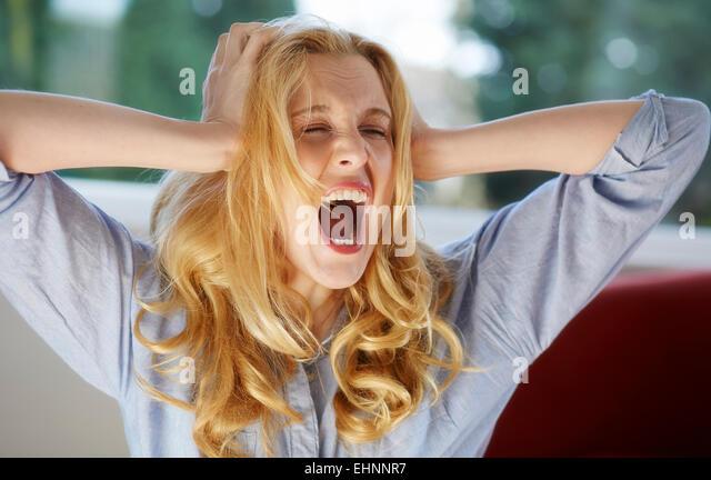Woman screaming - Stock Image