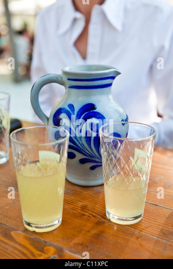 Cider and cider glasses with with a cider jug, Frankfurt, Hesse, Germany, Europe - Stock Image