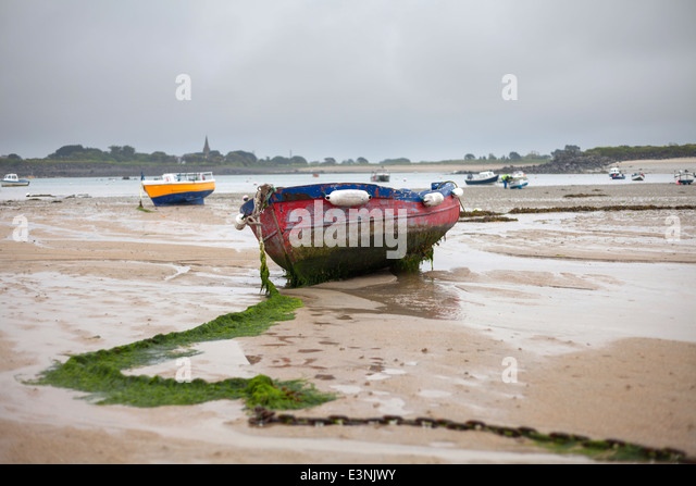 Tide out Le Grand Havre Guernsey - Stock Image
