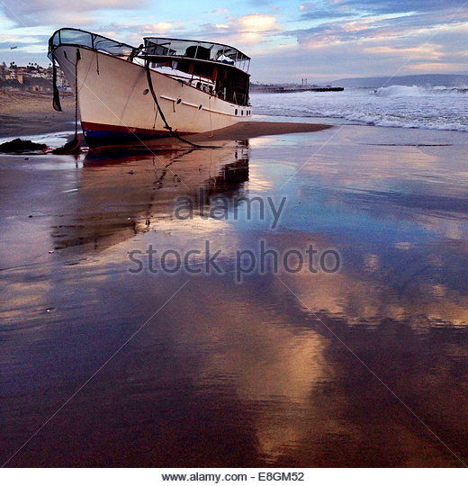 Boat moored on beach - Stock Image