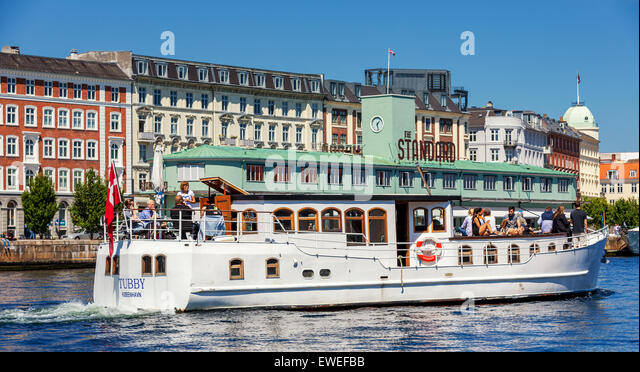 Tourist boat in front of the Standard, Copenhagen harbour, Denmark - Stock Image