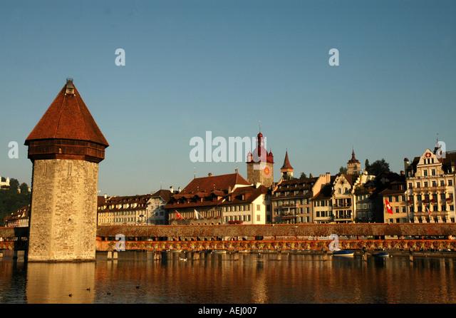 Lucerne luzern Switzerland Chapel Bridge or Kapellbrucke Water Tower Town Hall in Background - Stock Image