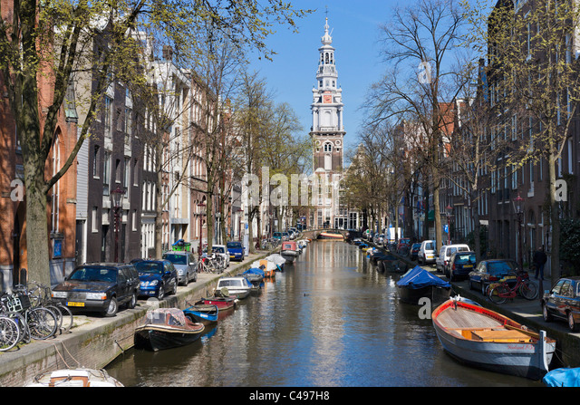 The Zuiderkerk at the end of the Groenburgwal canal in Spring, Amsterdam, Netherlands - Stock Image