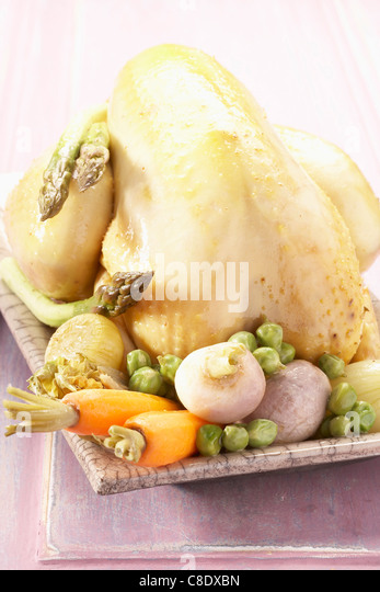 Chicken with spring vegetables - Stock Image