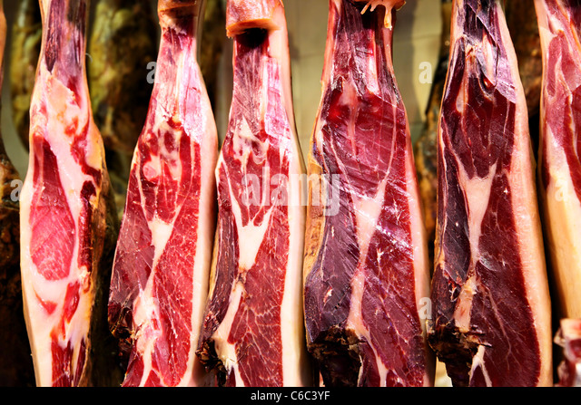 Spanish ham - legs of jamon iberico close-up - Stock Image