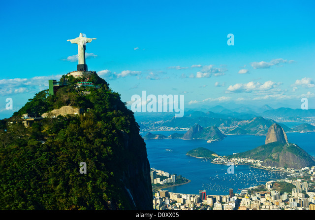 Christ the Redeemer statue overlooking Rio de Janeiro and Sugarloaf Mountain, Brazil - Stock Image