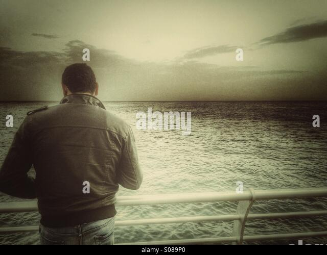 Man by the sea - Stock Image