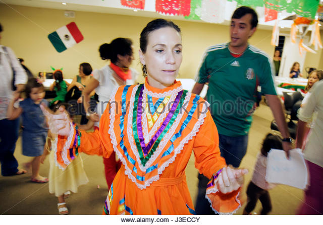 Miami Florida Miami Art Central Festival Mexico Miami Jalisco dress outfit Hispanic woman man girls boys children - Stock Image