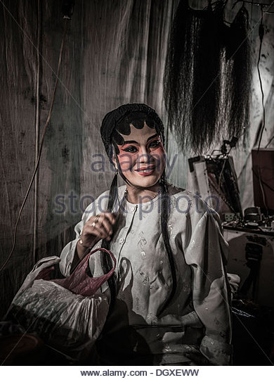 Chinese opera actor in full make up and attire backstage before a performance. Thailand S. E. Asia - Stock Image