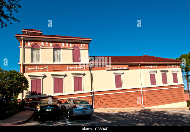 Ripley's Believe It Or Not attraction tilting building and cars on International Drive, Orlando Florida - Stock Image