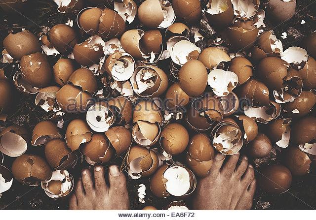 Self-photograph of woman standing on eggshells - Stock Image