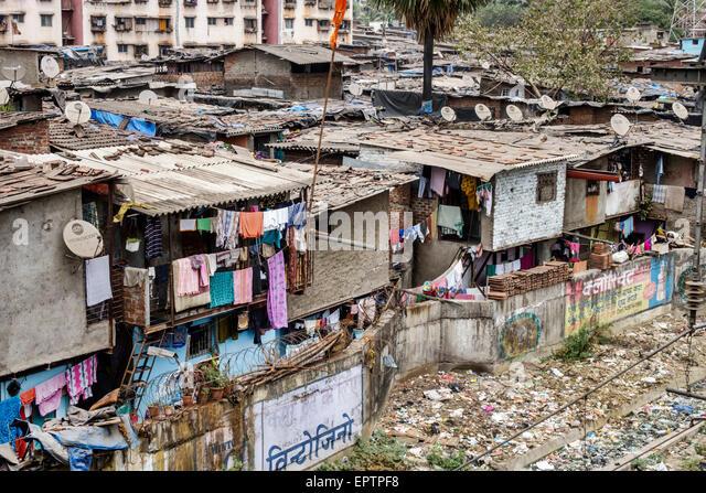 Mumbai India Asian Dharavi Kumbhar Wada slum shanties high population density poverty low income poor - Stock Image