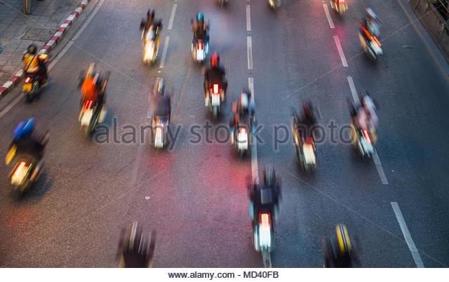 People riding motorbikes on busy road in Bangkok, Bangkok Metropolis, Krung Thep, Thailand - Stock Image