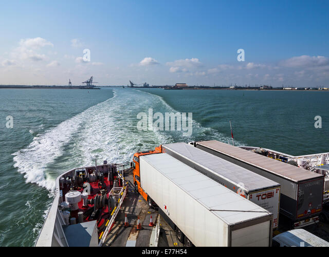 Articulated lorries loaded aboard a ro-ro cross-channel ferry departing from Dunkerque - Stock Image