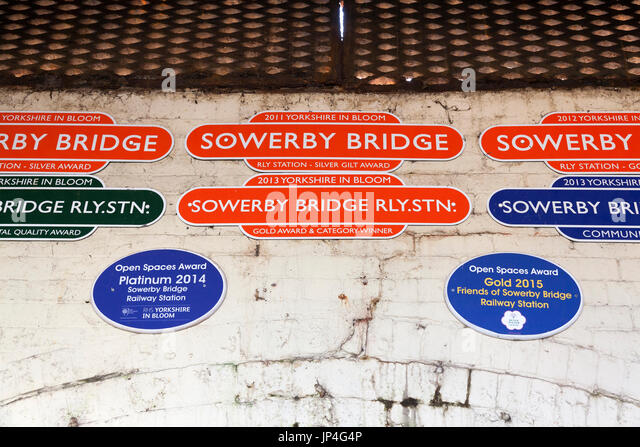 Yorkshire in Bloom winners plaques at the railway station, Sowerby Bridge, West Yorkshire - Stock Image