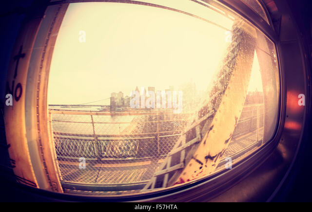 Vintage instagram stylized fisheye lens view of Manhattan from train window. - Stock Image
