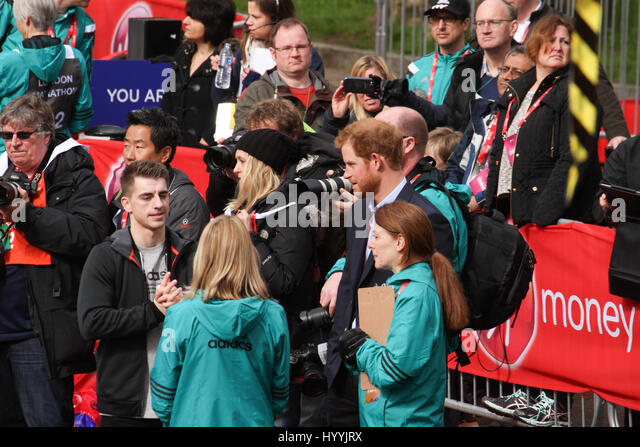 ​​​London, UK 24 April 2016. HRH Prince Harry, Patron of The London Marathon Charitable Trust, chats with mini marathon - Stock Image
