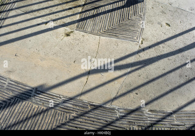 Ground / walkway texture and shadows at Tower Hill Memorial at Trinity Square Gardens, London EC3. - Stock Image
