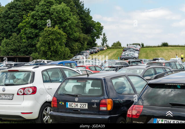 KORNELIMUENSTER, GERMANY 18th June 2017 - temporary car park on a meadow. Set up for the historic fair of Kornelimuenster. - Stock Image