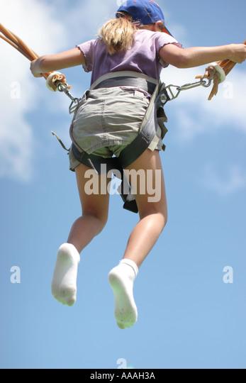 Florida, bungee safety harness, trampoline, gymnastics, jumping, acrobatics, girl, - Stock Image