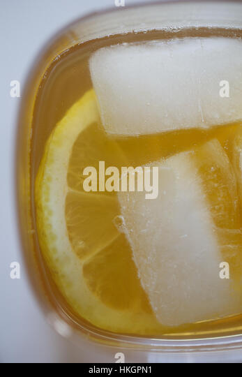 close up of orange slice in juice. drink, fruit, refreshment, food. - Stock Image