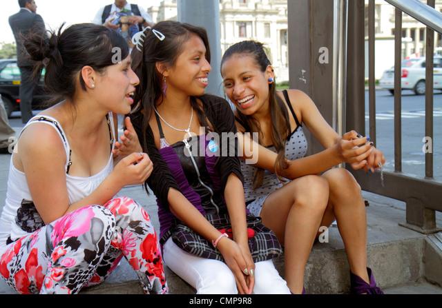 Peru Lima Estacion Central station Metropolitano Bus Line Calle Espana Hispanic girl girls teen student sitting - Stock Image