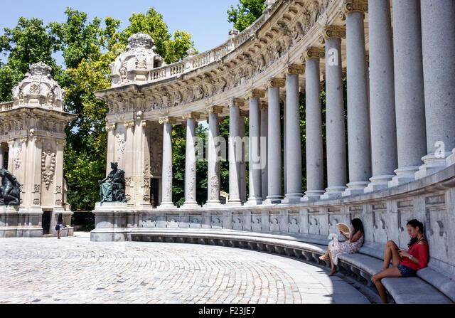 Madrid Spain Europe Spanish Retiro Parque del Buen Retiro Buen Retiro Park city park King Alfonso XII monument colonnade - Stock Image