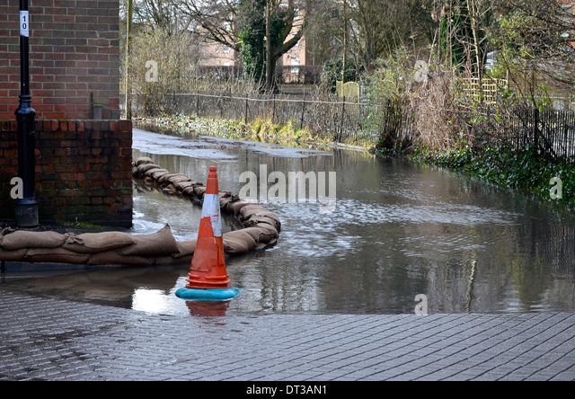 Sandbags and flooding in Water Lane, Winchester in February 2014 as River Itchen overflows it's banks. - Stock Image