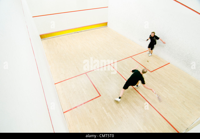 Two men playing squash - Stock Image