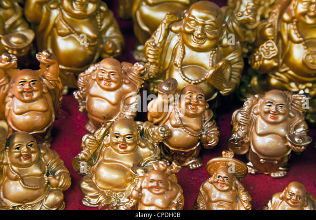 Mini Buddha figures for sale in a shop in Mumbai, India, Asia - Stock Image