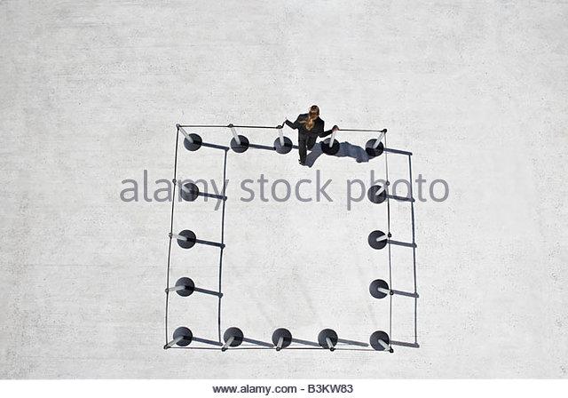 Woman leaving cordon posts - Stock-Bilder