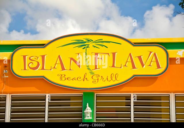 Islan Flava restaurant sign on Front Street in Philipsburg, St Maarten - Stock Image